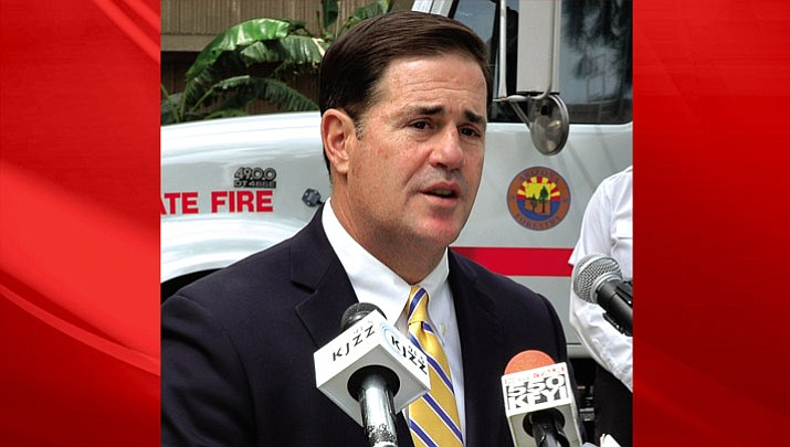 Gov. Doug Ducey on Tuesday ahead of speaking with reporters on criticism by teachers of his decision to sign legislation expanding the state's voucher program.
