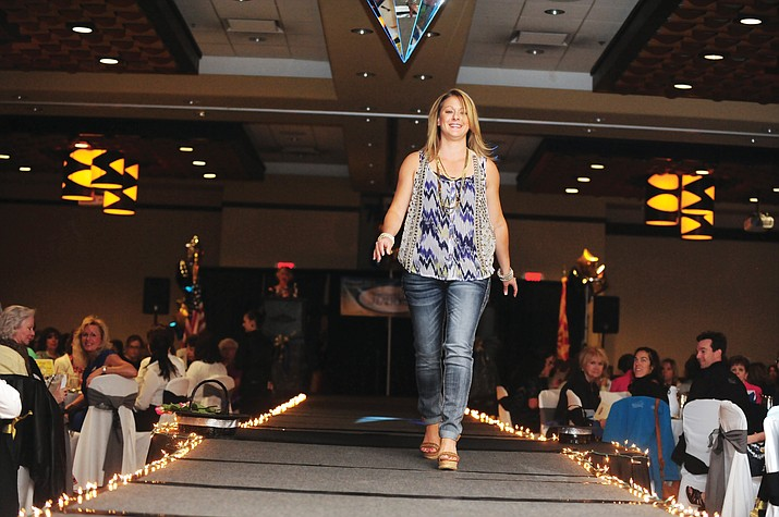 Terri Morotto models an outfits by Buckle and Brama Sole at the 2014 Women's Council of Realtors spring fashion show.