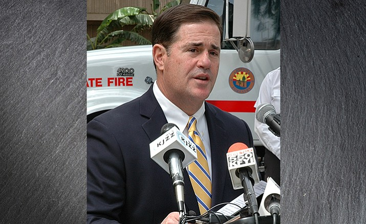 Gov. Doug Ducey on Tuesday ahead of speaking with reporters on criticism by teachers of his decision to sign legislation expanding the state's voucher program. (Capitol Media Services photo by Howard Fischer)