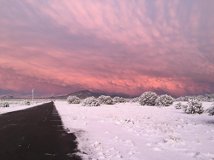 A spring storm rolled through Williams March 3 dropping up to an inch of snow on the ground. As the sun set after the storm, the northern Arizona sky was streaked with pink and purple clouds over the Red Lake area.