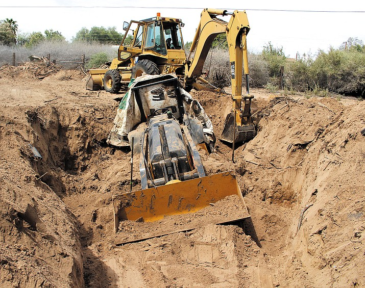 Law enforcement officials discovered a reported stolen tractor buried on property in the 1500 block of Pinion Road in Mohave Valley Tuesday.