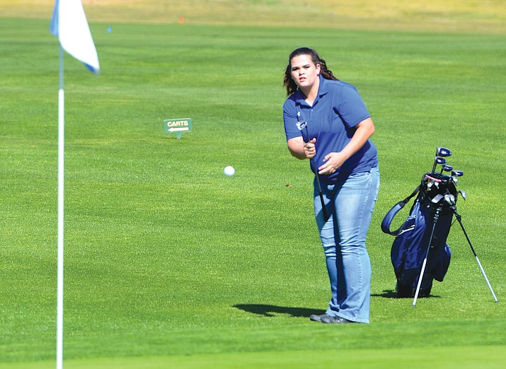 Camp Verde senior Marisa Presmyk hits the ball onto the green on the first hole at  Verde Santa Fe Golf Course on Monday in the match against Chino Valley. Presmyk won the No. 2 match by two strokes, shooting a 61 on the nine holes.(VVN/Vyto Starinskas)