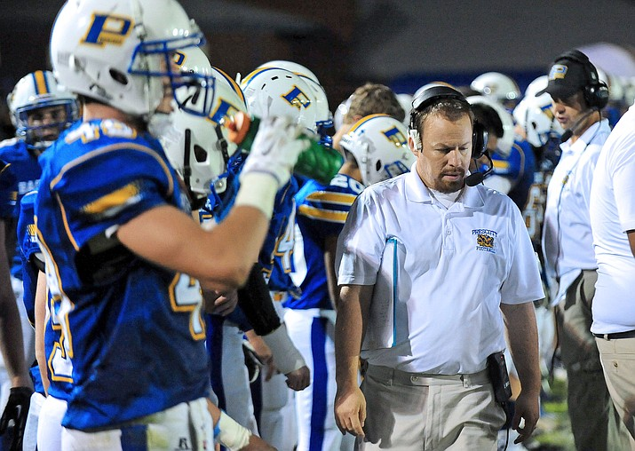 Former Prescott football head coach Cody Collett walks the sidelines against Youngker on Sept. 12, 2014, in Prescott. After resigning in December 2015, Collett is making his return to Prescott and will coach tight ends under current head coach Michael Gilpin. (Matt Hinshaw/Courier, File)