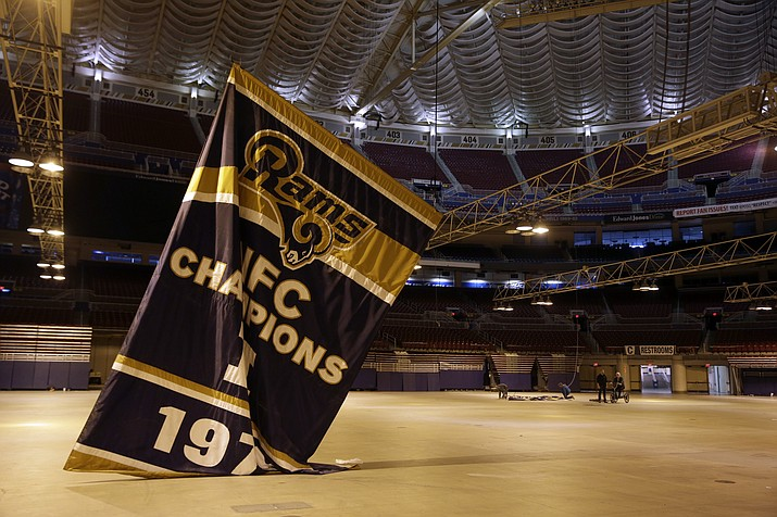 In this Jan. 14, 2016, file photo, championship banners are removed from the Edward Jones Dome, former home of the St. Louis Rams football team in St. Louis. (Jeff Roberson/AP, File)
