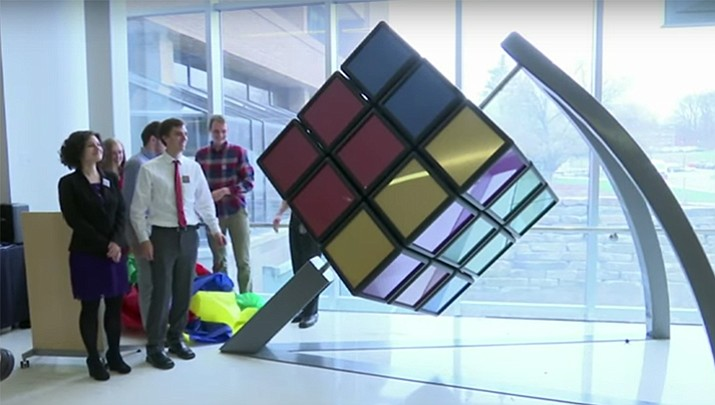 University of Michigan mechanical engineering students designed and built a 1,500-pound Rubik's Cube, which they unveiled on Thursday, April 13 at Brown engineering building in Ann Arbor, Mich