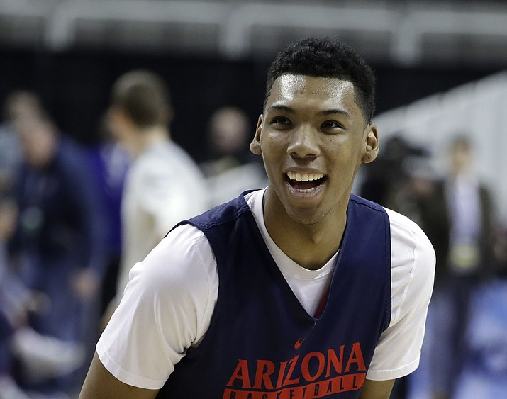 Arizona guard Allonzo Trier (35) smiles as he shoots during practice Wednesday, March 22, in San Jose, Calif., as the team prepares for an NCAA men's college basketball tournament West Regional semifinal against Xavier on Thursday. (Marcio Jose Sanchez/AP)