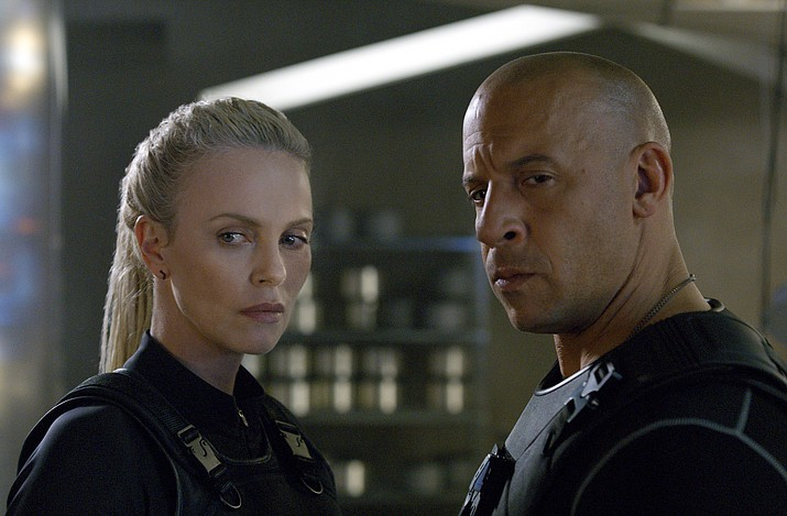 "Charlize Theron, left, and Vin Diesel star in Universal Pictures' ""The Fate of the Furious."""