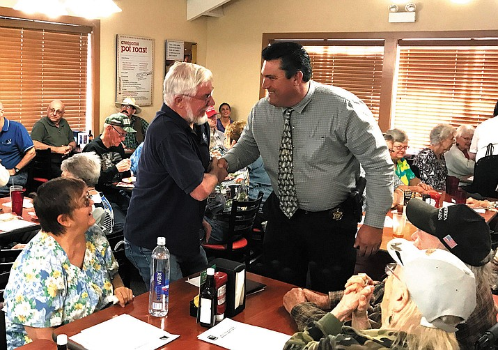 Bob Simmons (left) greets Mohave County Sheriff Doug Schuster at the Mohave Republican Forum Wednesday evening.