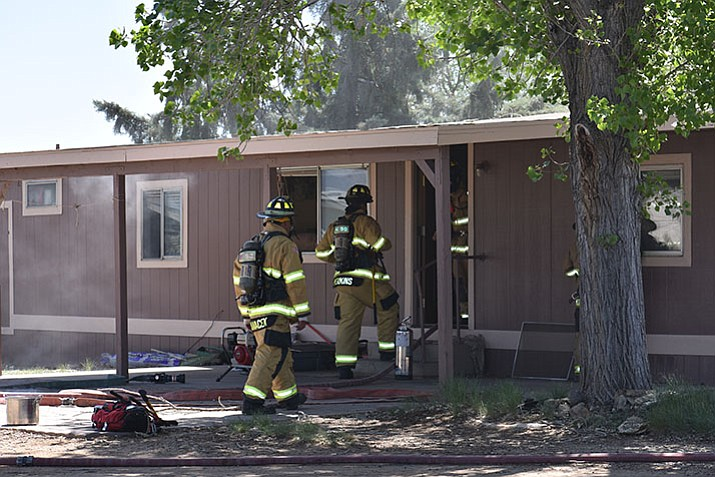 Firefighters respond to a report of a structure fire on Carla Vista Drive in Prescott Valley Thursday. A stove was left on with a pan of burning food.