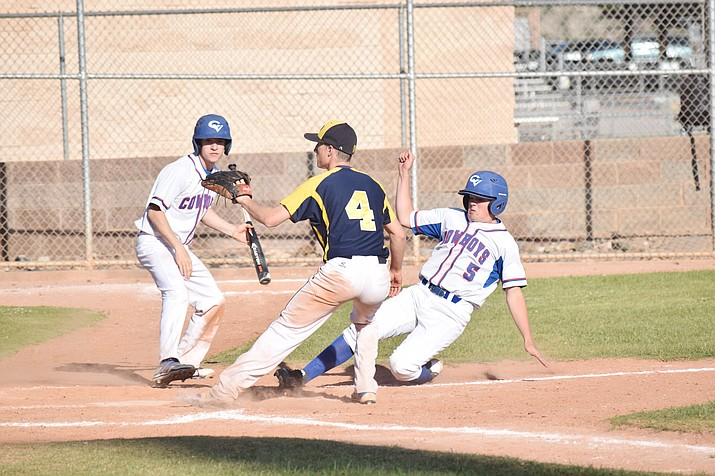 Camp Verde sophomore Dawson McCune scores during the Cowboys' 10-run fourth inning against Glendale Prep on Thursday. Camp Verde beat the Griffins 14-1 and have won seven of their last eight games. (VVN/James Kelley)