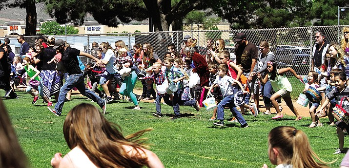 Kids and parents run at the start of the annual Easter Egg Hunt.