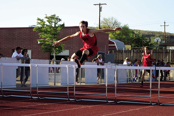 Lee Williams' Zach Tempert runs the 300-meter hurdles.