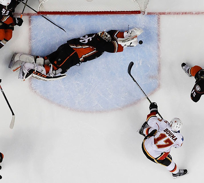 Anaheim Ducks goalie John Gibson blocks a shot by Calgary Flames left wing Lance Bouma during the second period in Game 2 of a first-round NHL hockey Stanley Cup playoff series in Anaheim, Calif., Saturday, April 15. At press time, the Ducks and Flames were tied at 2-2 in the second period.