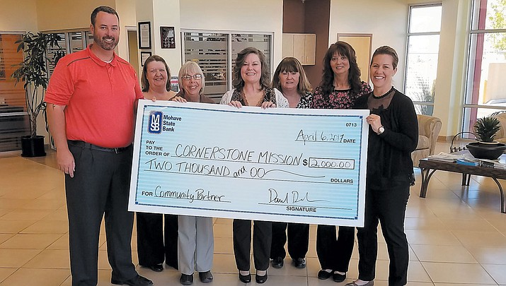 Dan Del Monaco, Mohave State Bank vice president and branch manager, and staff present a check for $2,000 to Cornerstone Mission Executive Director Lisa Fitzgerald. Pictured from left: Dan Del Monaco, Cindy Humphries, Laurie Reed, Lisa Fitzgerald, Wanda Van Den Hende, Char Skarpnes and Chanel Turner.