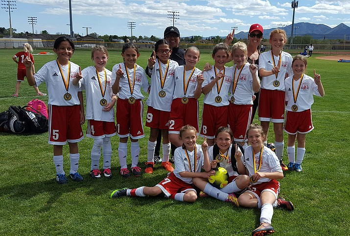 The Kingman G06 Girls team after winning the Yavapai Cup.