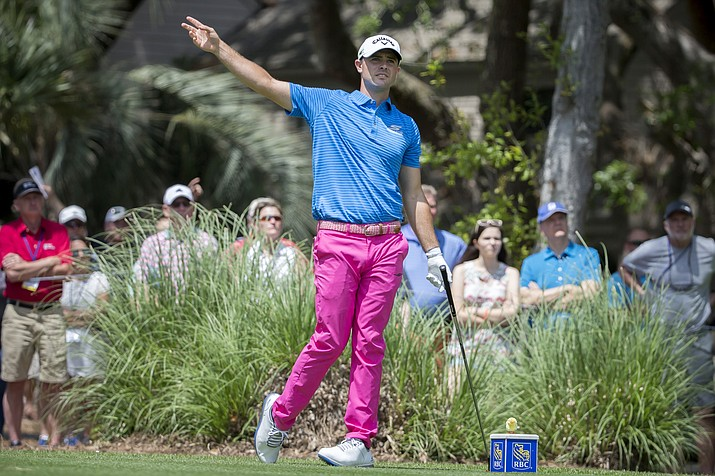 Wesley Bryan warns spectators of a wayward shot from the second tee during Sunday's RBC Heritage golf tournament.