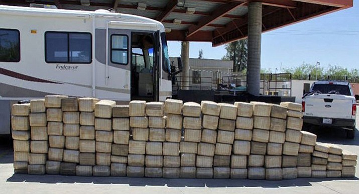 U.S. Customs and Border Protection says officers at the Lukeville crossing found 2,600 pounds (1179 kilograms) of marijuana when led to it by a drug-sniffing dog during a secondary inspection of the vehicle Saturday.