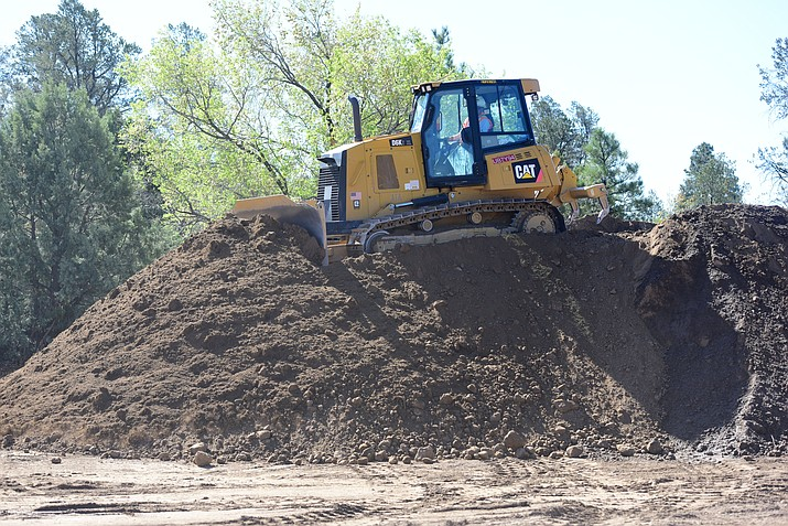 A bulldozer moves the last pile of dirt that Engineering Remediation Resource Group will move to a Phoenix landfill later this week as they have almost finished cleaning up the dirt with high lead content at the former Prescott Sportsmen's Club Shooting Range bear Granite Basin Tuesday, April 18 in Prescott.  (Les Stukenberg/Courier)