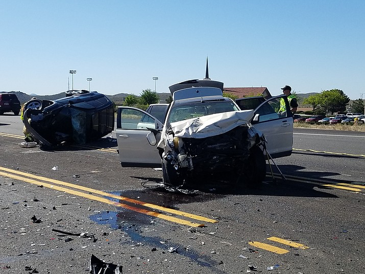 The intersection of Highway 69 and Spring Lane was the scene of a two-vehicle crash Tuesday morning, involving a Toyota SUV, left, and a Ford. An elderly man, driving the Toyota, died at the scene.