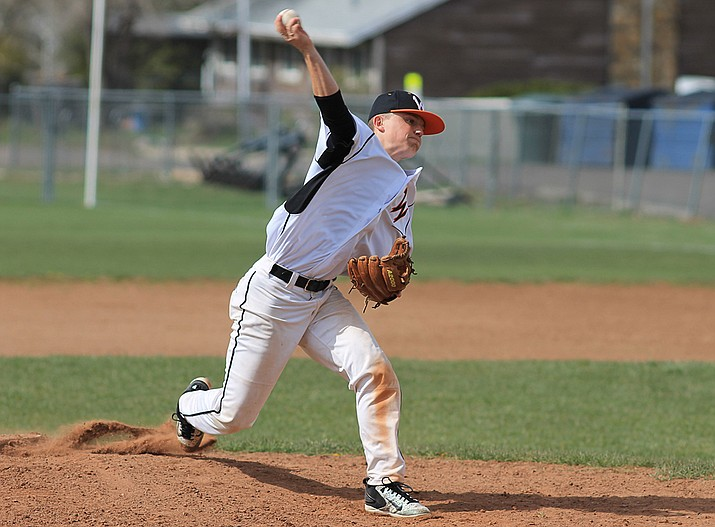 Kolby Payne pitches during a game with Greyhills Academy.