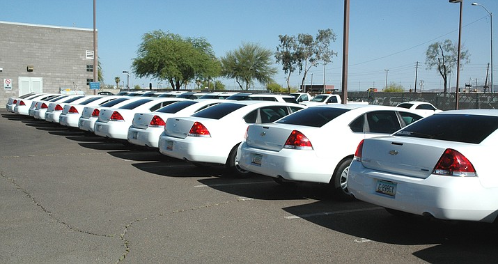 Some of the more than 10,000 vehicles in the state's fleet.  (Capitol Media Services photo by Howard Fischer)
