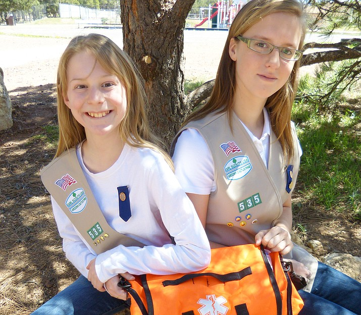 Alana Nelson and Betsey Sullivan hold one of the medical bags that Betsey's project provided to the school's sports teams.