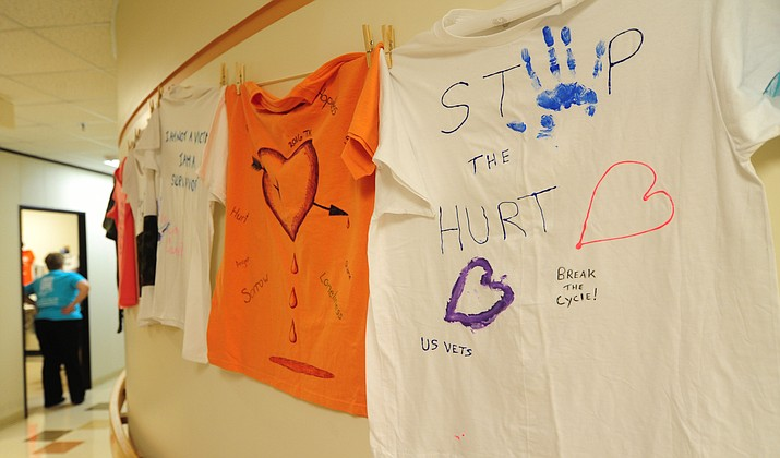 Some of the shirts on display as part of the Clothesline Project highlighting sexual trauma for veterans Wednesday, April 19 in Prescott.  (Les Stukenberg/Courier)
