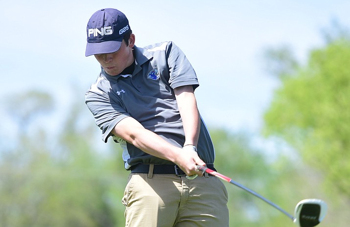 Chino Valley's Wyatt Dodds tees off as the Cougars take on Wickenburg and Northland Prep in golf Wednesday, April 19, at the Antelope Hill Golf Course in Prescott. (Les Stukenberg/Courier)