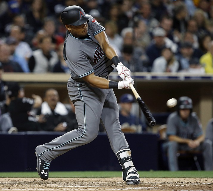Arizona Diamondbacks' Yasmany Tomas hits a three-run home run against the San Diego Padres during the fifth inning Tuesday, April 18, in San Diego. (Alex Gallardo/AP)