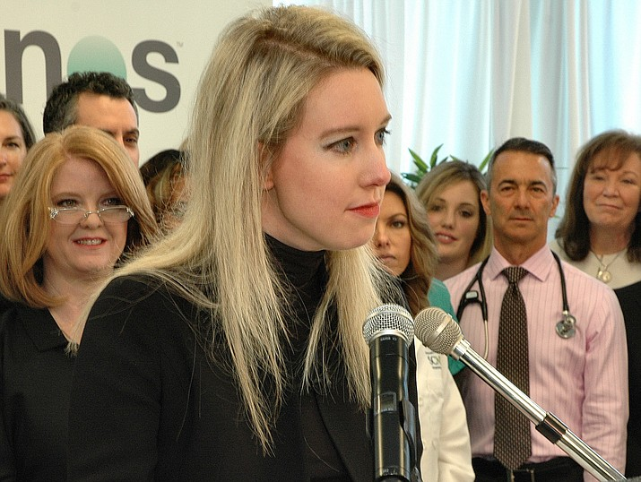 Theranos founder Elizabeth Holmes at 2015 ceremony where Gov. Doug Ducey signed legislation at her firm's Scottsdale office allowing her company and others to offer blood testing directly to Arizona consumers.  (Capitol Media Services file photo by Howard Fischer)