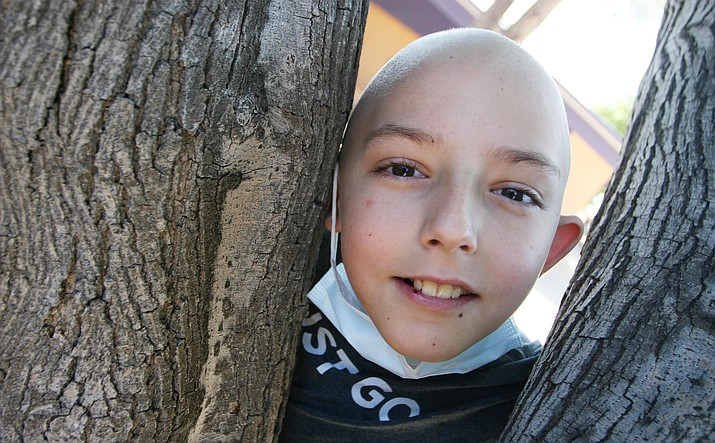 Dillin LaRue in a rare visit to his Cottonwood Elementary School. Dillin, age 10, is fighting Ewing Sarcoma, a rare malignancy the size of a baseball in his right lung. (Photo by Bill Helm)