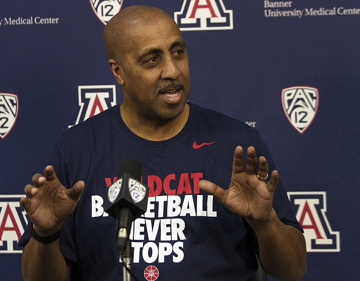 Lorenzo Romar answers questions during an NCAA college basketball press conference, Thursday in Tucson. (Courtney Talak/AP)