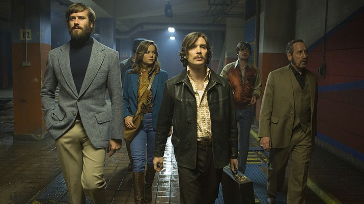"This image released by A24 shows, from left, Armie Hammer, Brie Larson, Cillian Murphy, Sam Riley and Michael Smiley in a scene from ""Free Fire."" 