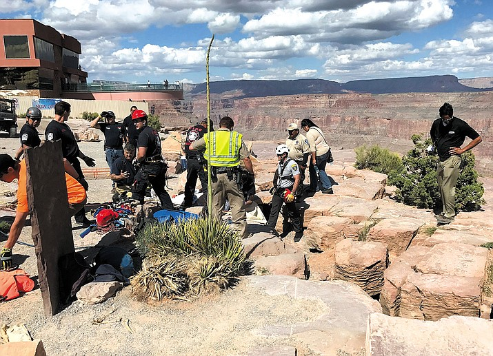 MCSO Search and Rescue, along with DPS and Grand Canyon West Fire Department personnel, work to free a woman who fell 50 feet down a crevice.