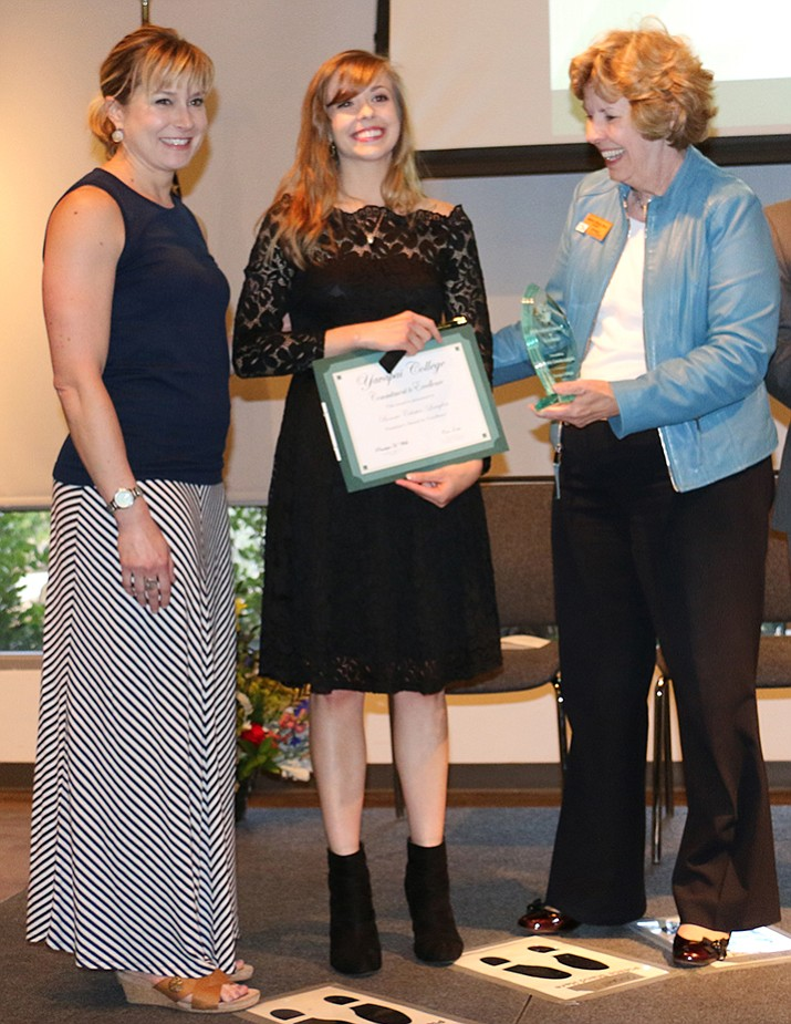 Bonnie Celestin-Langlois, middle, receives the President's Award for Excellence from Yavapai College President Dr. Penny Will, right, and Sociology Professor Dr. Jennifer Jacobson, left, during the Prescott Evening of Recognition celebration on April 17.