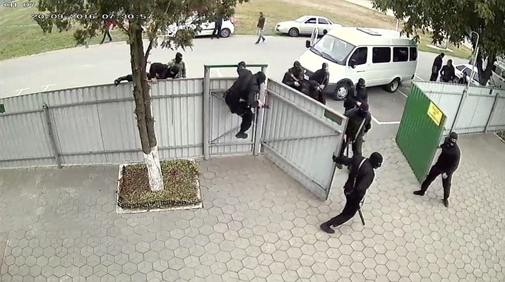 Screenshot from a Sept. 20, 2016 surveillance video that captured footage of armed law enforcement officers raiding a Jehovah's Witnesses church facility in the village of Nezlobnaya in Stavropol territory, Russia. (See video provided below.)