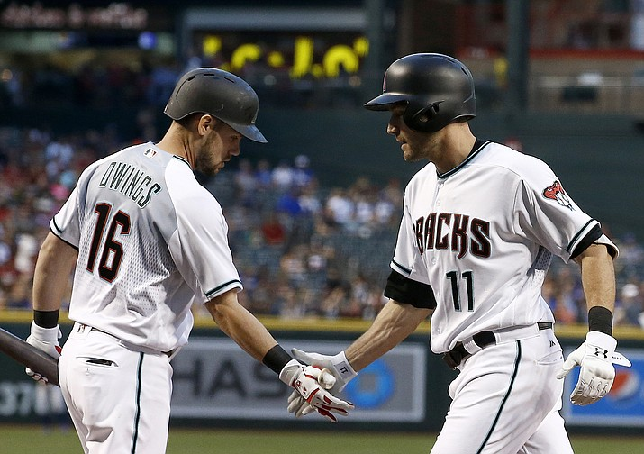 Arizona Diamondbacks' A.J. Pollock (11) celebrates his home run against the Los Angeles Dodgers with Chris Owings (16) during the first inning of a baseball game Friday, April 21, in Phoenix. (Ross D. Franklin/AP)