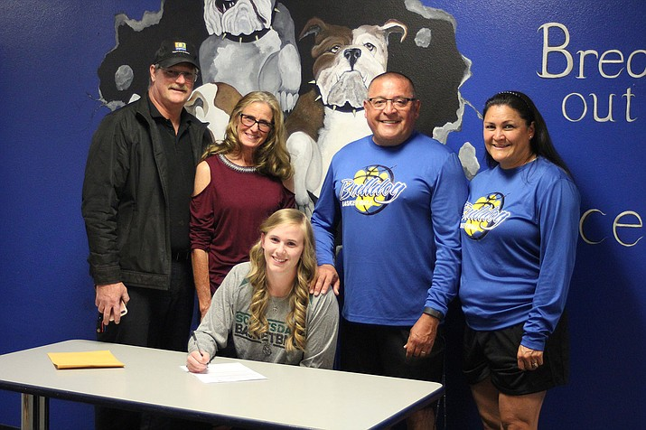 Kim Carroll signed Friday to play at Scottsdale community College. Back row from left: Jim Carroll, Paula Carroll, Danny Gonzalez and Melissa Gonzalez