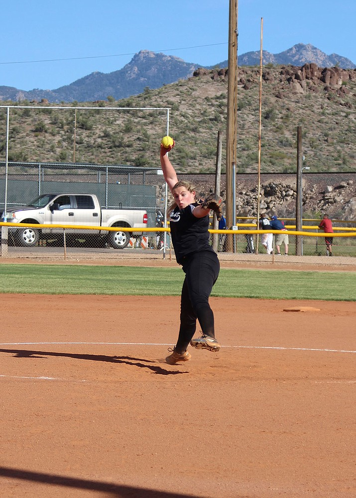 Kingman Academy's Jessica Plew throws a pitch Friday against Parker at Southside Park. Plew allowed just one hit and struck out nine in an 11-0 victory.