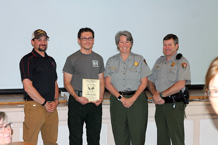 Li Brannfors with Grand Canyon Superintendent Chris Lehnertz  and Chief Ranger Matt Vandzura after receiving a regional Excellence in Fire Management award.