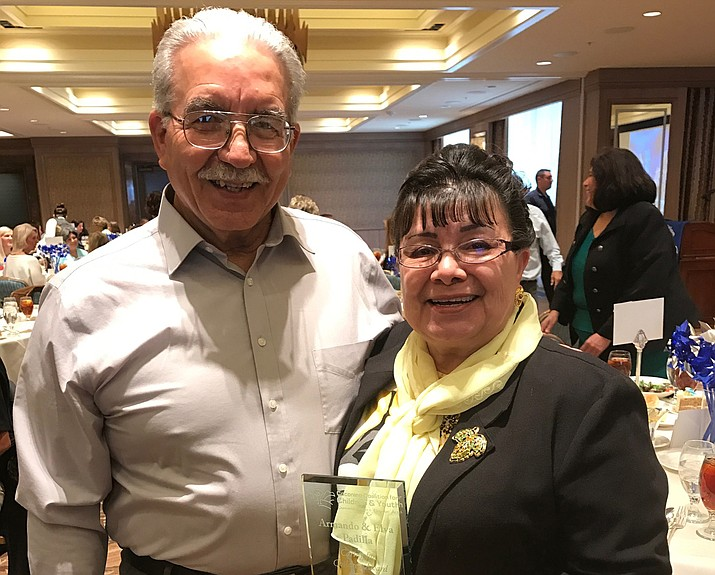 Elva and Armando Padilla were awarded with a Caring for Children award from the Coconino Coalition for Children and Youth.