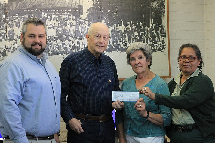 Al Richmond (center), a member of the Grand Canyon Historical Association, presents a $1,500 check to the Williams Library Historic Photo Preservation Project April 13. From left: City Manager Skylor Miller, librarian Andrea Dunn and Kaibab National Forest historian Margaret Hangan accept the check from Richmond.