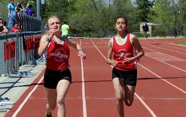 Kyla Pearce and Cayli Miles compete in the 200m dash.