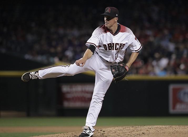 Arizona Diamondbacks starting pitcher Zack Greinke throws against the San Diego Padres during the sixth inning Monday, April 24, in Phoenix. (Matt York/AP)