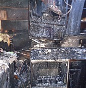 Kitchen stove fire extends into home's attic photo