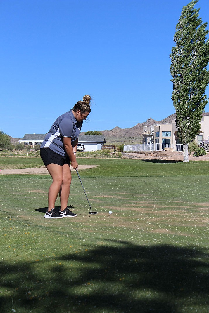 Kingman Academy's Shelby Swanty putts on hole No. 8 Tuesday at Valle Vista Golf Course.