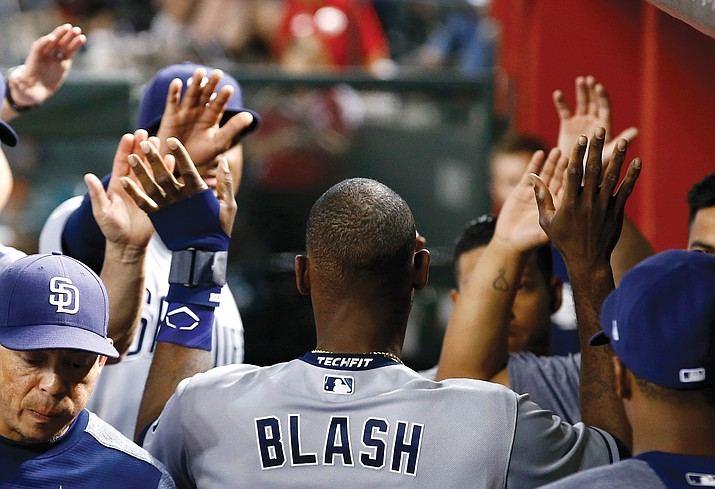 San Diego's Jabari Blash celebrates scoring against the Diamondbacks during the fourth inning of a baseball game, Wednesday, April 26, in Phoenix. (Ross D. Franklin/AP)
