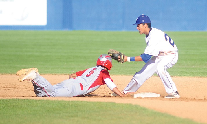 Prescott's Raymundo Chairez tries to tag out a Mingus Union's Jose Pacheco as the Badgers take on Mingus in varsity baseball Tuesday, April 25 in Prescott.  (Les Stukenberg/Courier)