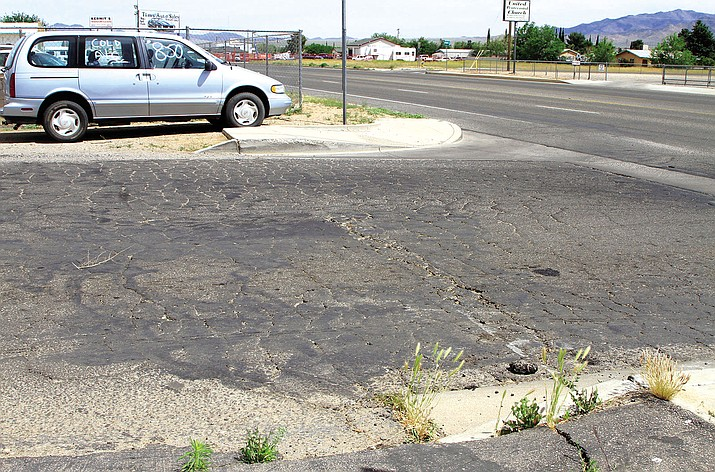 Roads maintained by Mohave County, such as Lomita Street at Norhtern Avenue, are deteriorating faster thanks to the state siphoning funds.