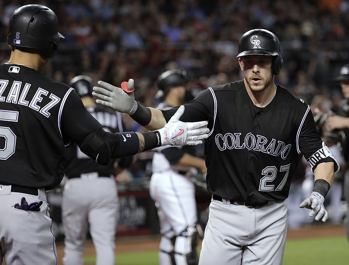 Colorado Rockies' Trevor Story celebrates his solo home run with Carlos Gonzalez (5) against the Diamondbacks during the third inning of Friday's baseball game.